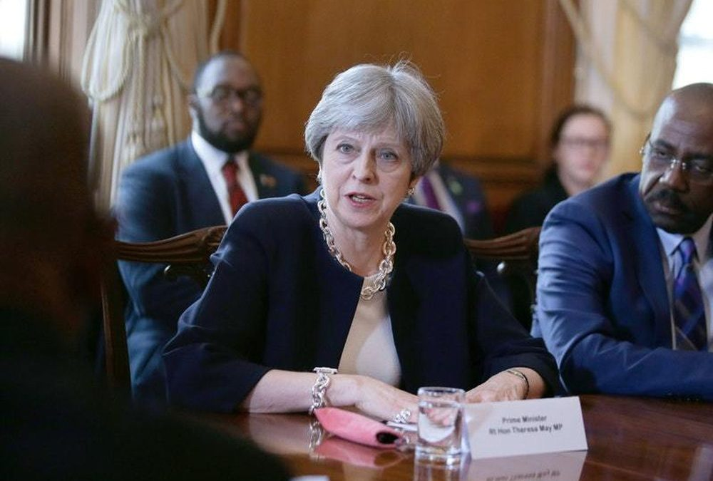 Theresa May extends apology over Windrush deportation scandal